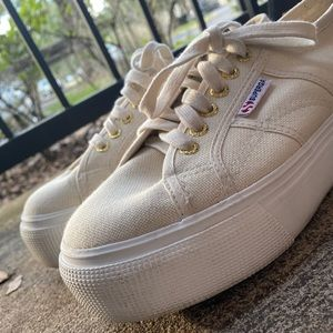 Cream colored platform sneakers!